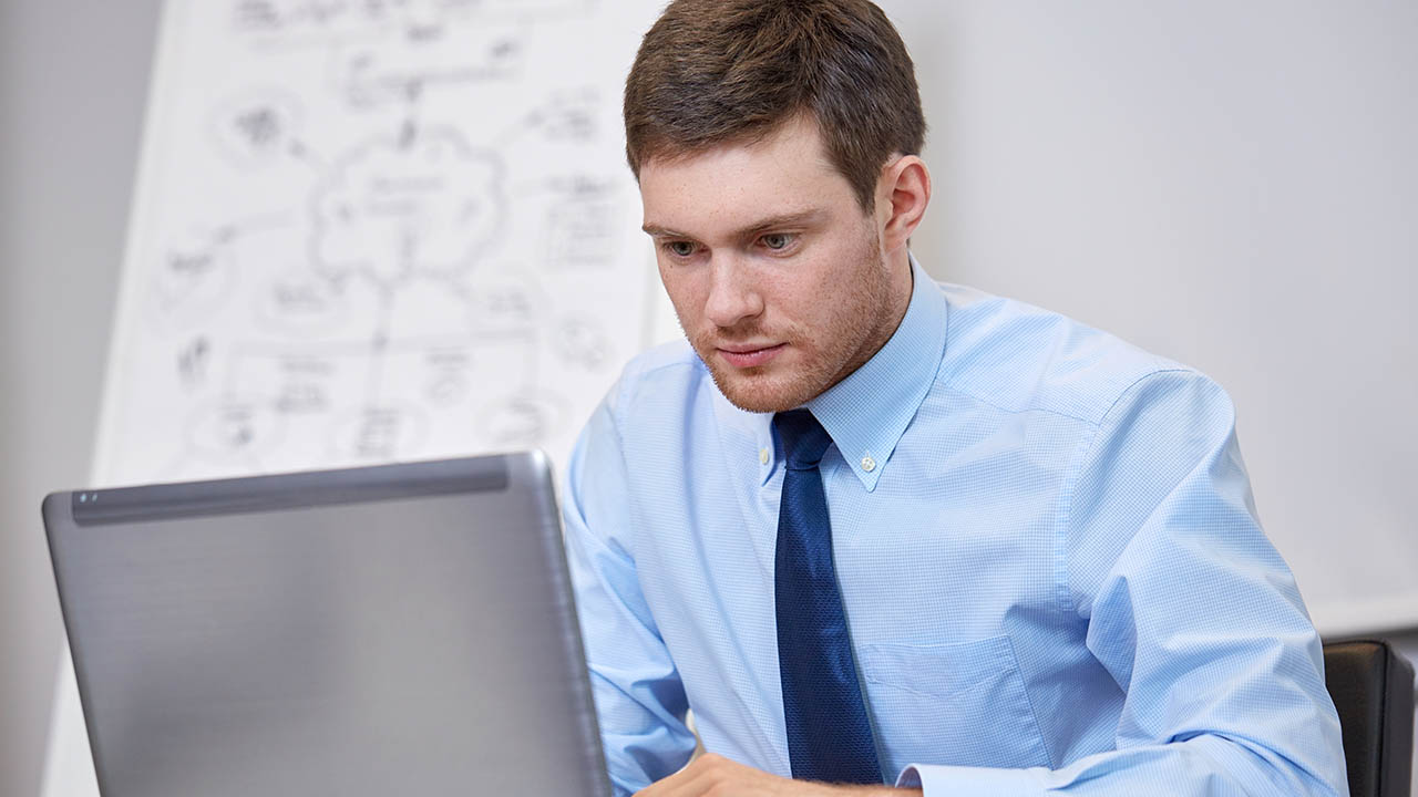 businessman sitting with laptop in office
